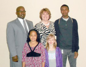 Dr. Terrell Carter, his wife Melinda Carter, son Malik Carter, daughter Victoria Carter, and family friend Phoebe.