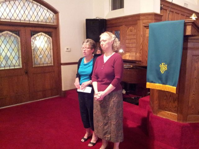 Wyndy McRoy and Rev. Leslie Limbaugh wait to greet congregational members at the end of the Sept. 29, service.