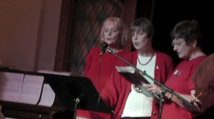 Kathy Bruce, Carolyn Kuykendall, and Pat Clark perform a patriotic song to entertain the 2014 Winter Banquet crowd.