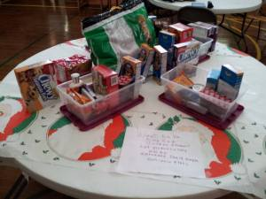 JOY Class has been collecting goodies to help our students away at school with winter care packages.
